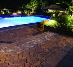 This pool deck is paved with Nicolocks Village (Antiqued) pavers with their Golden Brown color blend.  Nicolock uses Davis Colors concrete pigments to make their custom color blends.  To learn more about Nicolocks products visit them at www.nicolock.com.