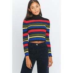 59fd09f72eb Shop Urban Outfitters Rainbow Striped Black Turtleneck Jumper at Urban  Outfitters today.