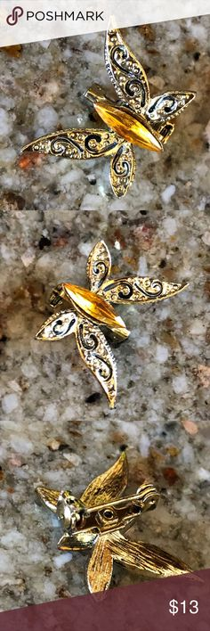 Butterfly Pin Costume jewelry is always a fun added touch to any outfit‼️ This butterfly pin is gold tone with a yellow center stone how cute for a collar on a dress, top, or jacket Jewelry Brooches