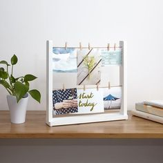 Casual desk top multi frame with two rows of twine for displaying favourite photos, memos, cards and artwork. Also, suits tabletop and mantle spaces. Comes with 9 clothespins.