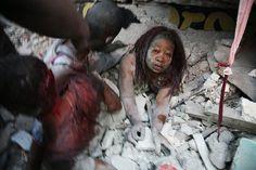 2nd Prize Spot News Single. Daniel Morel, Haiti. Rescue of a woman trapped under earthquake rubble, Port-au-Prince, 12 January