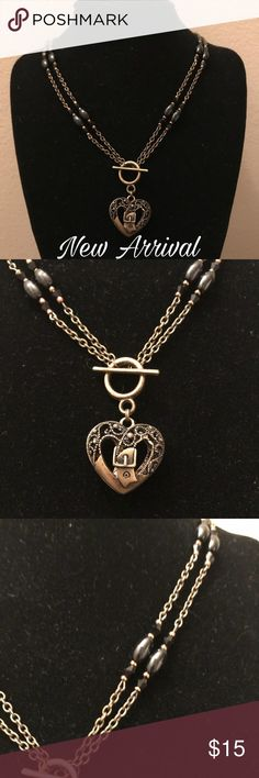 2 Ways to Wear Handmade - Brass/Black Heart Gorgeous handmade 2 Ways to Wear Necklace with Brass & black beads and a heart pendant. The chain is about 34 inches worn long and 17 doubled over.  The pendant is 3/4 inches.  Also can be made with a ring or perfume bottle pendant.  Make an offer today! Sidlee Jewelry Jewelry Necklaces