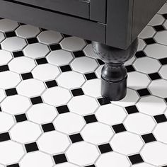 White & Black Tile floor and Black Cabinet  Feet extensions made from dowels level the vanity on the uneven floor.  Tile: Daltile