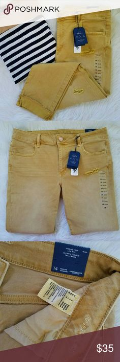 "AE Crop Jeggings Mustard Yellow American Eagle Outfitters Womens size 14 Regular. Jegging Crop jeans. Super super stretch. Gorgeous and unique mustard yellow color. ""Destroyed""  Brand new with tags. American Eagle Outfitters Jeans Ankle & Cropped"