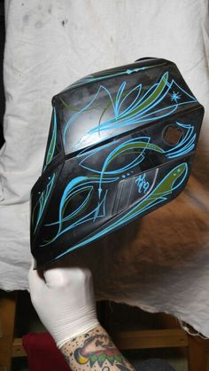 Free hand pinstriping on a welding helmet. If you are interested in any custom art work similar to this or any style please contact me at knucklehed7@gmail.com. You can also check out my work at www.Facebook.com/knucklehedkustomartanddesign