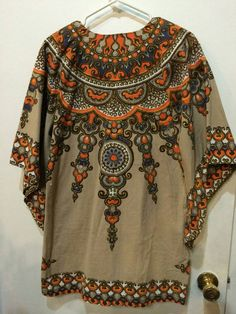Check out this item in my Etsy shop https://www.etsy.com/listing/263826491/1960s70s-dashiki-tunic