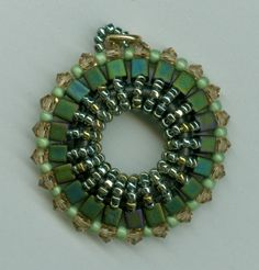 Circle Pendant with cubes and seed beads by Marcie Lynne