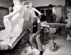 Auguste Rodin (1840-1917) seated beside his work in his studio.    Photo by Dornac (Paul Francois Arnold Cardon) (1859-1941) Archives Larousse, Paris, France.