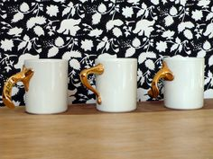 Fines formes Gaudí mug collection.  Three knobs of their buildings now into our mugs