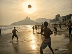 Young Men Play Beach Football on Ipanema Beach as the Sun Sets Papier Photo