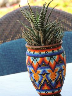 Huichol art - I love it! Wonder how long it takes to press all those itsy bitsy beads into place.