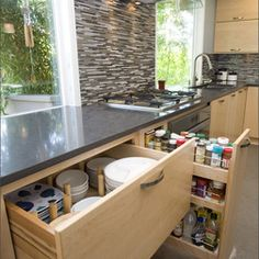 Dig the idea of plates and bowls in drawers and more open areas
