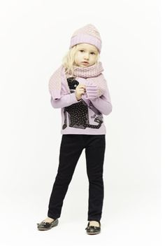 Pink sweater with matching hat and scarf
