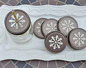 24 Pewter Daisy Cut Mason Jar Lids. $20.00, via Etsy.