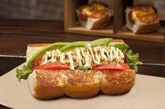 Dog Haus SOOO CALI - 100% all beef skinless dog topped with wild arugula, spicy basil aioli, crispy onions, avocado, tomato | Yelp