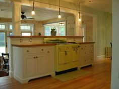 Old style kitchen complete with antique stove. The kitchen features inset door cabinetry with solid cherry counter tops. Draws are dovetailed solid Maple with Blum Tandem unermount slides. Pantry...