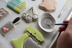 Painting and spraying cookies with lustre dust to give them shimmer-great blog with tons of tips.