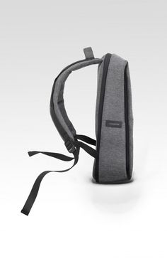 """Ergonomically styled with a taller body and more voluminous base, we've updated the Rhine Flat Backpack, bringing its functionality to the same exacting standards as its aesthetic. Available in black and black melange Eco Yarn, the Rhine New Flat Backpack is one of our lightest weight travel accessories, equipped with a padded laptop compartment that accommodates and protects a 15"""" laptop and iPad, with an internal divider for your documents and external zip pockets for ..."""