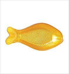 Sea Glass Yellow Fish Dish: The Sea Glass collection features brilliant metallic sea creatures beneath smooth glass. This bright yellow fish dish would be a cheerful and punchy accessory for your table or home. Handwash only.10