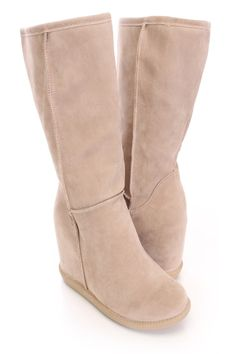 Be comfy yet stylish this season with these fashionable hidden wedge boots! They will go perfect with your favorite dress or skinnies! Make sure you add these to your closet, it definitely is a must have! The features include a faux suede upper with stitched detailing, round closed toe, smooth lightly cushioned lining, and cushioned footbed. Approximately 3 1/2 inch hidden wedge heels, 1 inch platforms, 15 inch circumference, and 9 inch shaft.