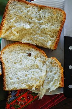 How to make basic white bread in a bread machine. Tips on how to make bread less dense, more airy and fluffy, using a basic bread machine recipe.