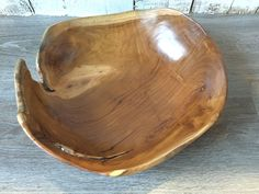 A deluxe and unique Indonesian root bowl, perfect for displaying fruit, salads,bread or simply leave this stunning bowl as it is to take in the natural beauty of the grain.  This bowl has been hand crafted from natural teak root, sourced from responsibly managed forests, it is both solid and substantial and is a stunning piece of functional art.