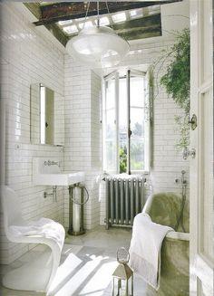 tiled, sunny, industrial // skylight bathroom with subway tile walls, marble tub // wood beams