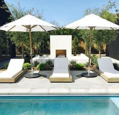 This last pic is from last year's Newport Harbor Home Tour. All white lounge chairs, umbrellas and even an outdoor fireplace are once again an white elegant look, and offer you that resort vibe too! So what do you think?: white for the backyard #LandscapingandOutdoorSpaces