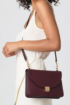 Pairing ingenious Italian construction with dynamic design, the Lock Shoulder Bag is rendered in classic Italian calfskin with precise lines that have been hand-painted along the edges. Custom gold hardware completes the vision: comprised of clasps that fasten a detachable strap and feminine lock closure. The smooth exterior is punctuated by accordion side pleats, opening to reveal three distinctive compartments inside.