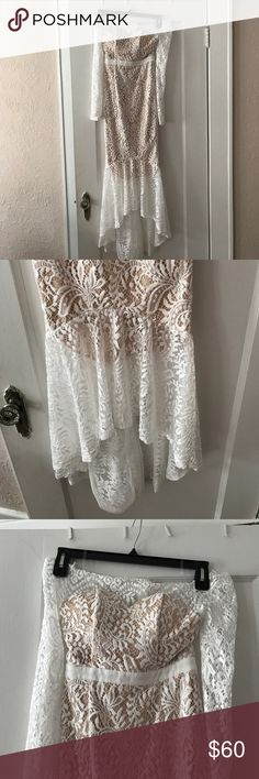 """NWT Vici White Strapless Dress I bought this from Vici, but the tag says L'atiste. I am a 34B, waist is 28"""". It's a trumpet dress. I was going to wear it for my wedding reception, but decided it didn't fit the style of my wedding. Dresses High Low"""