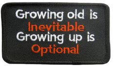 """Amazon.com: [Single Count] Custom and Unique (2"""" by 3 1/2"""" Inches) """"Growing Old Is Inevitable Growing Up Is Optional"""" Text Iron On Embroidered Applique Patch {Orange, White & Black Colors}: Arts, Crafts & Sewing"""