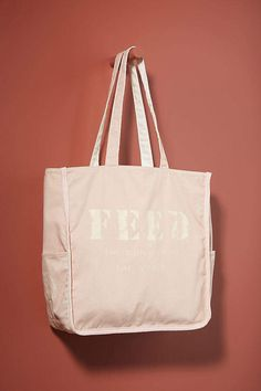 FEED Side-Pocket Tote Bag By FEED in Pink, #Anthropologie, commission link Lauren Bush, Blue Bar, Capri Blue, Felder, Children In Need, Small Bags, Purses And Handbags, Bag Accessories, Gym Bag