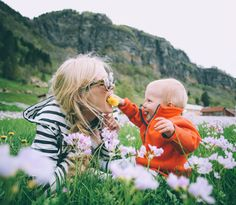 Mom and baby in the green grass and flowers....