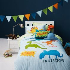 Cool quirky dinosaur bedding. Great for little boy's bedroom. Sleep with T rex triceratops dinosaur.