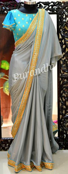 Gray Georgette saree finished with beautiful Kundans Stones and Jari worked bor. Half Saree Designs, Pattu Saree Blouse Designs, Blouse Designs Silk, Designer Blouse Patterns, Bridal Blouse Designs, Pattern Blouses For Sarees, Designer Saree Blouses, Simple Blouse Designs, Stylish Blouse Design