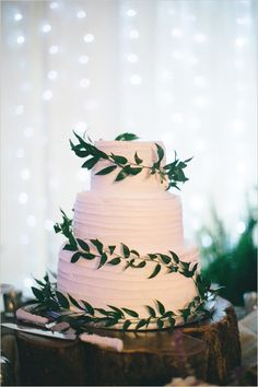 Rustic ivy-wrapped wedding cake.