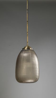brown cut glass pendant light with distressed brass rod and ceiling rose