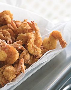 Bayou Fried Shrimp - whole milk - large egg - large shrimp - yellow mustard - Cajun seasoning - finely ground cornmeal - cayenne pepper - canola oil for frying