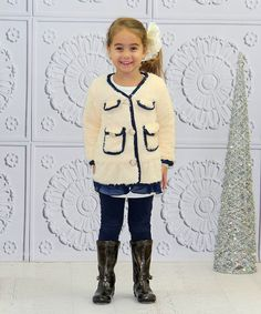 Wrap little ones in snuggly softness with this warm and whimsical jacket. Precious buttons, businesslike pockets and peekaboo tulle at the hem turn this fluffy piece into the perfect blend of comfort and charm. 100% polyesterHand wash; hang dryImported