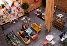 Story Hotel - art filled patio + kitschy furniture