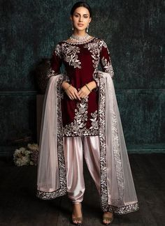 Deep Maroon and Light Pink Velvet Punjabi Suit features a velvet kameez with santoon inner, satin bottom and net embroidered dupatta. Embroidery work is completed with zari and stone work embellishments. Work Dresses For Women, Trendy Dresses, Tight Dresses, Clothes For Women, Trendy Outfits, Pakistani Dress Design, Pakistani Outfits, Indian Outfits, Dress Outfits