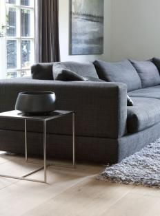 contemporary low mid grey sofa metal occasional table and pale blonde wood floor - woonmagazine