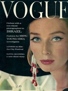 Model Tania Mallett wears a black hat and earrings Cartier.Vogue,July 1962.