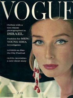 Model Tania Mallett wears a black hat and earrings Cartier.Vogue,July 1962.
