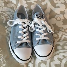 NWOT - Converse All-star low top sneaker Grey/blue color. So cute with skinnies and a T! Nothing wrong with them, I just never reach for them so they need to go. Only selling the sneakers, the last pic is just for ideas! No box, sorry. Converse Shoes Sneakers