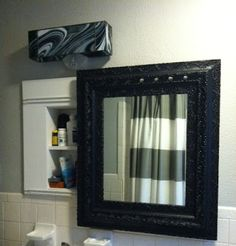 Recessed medicine cabinet concealed behind sliding mirror