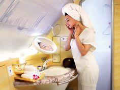 Shower Spa in beautiful walnut and marble on board....a plane.....Emirates A380