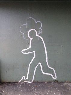 Street art in Trondheim (Norway) - walking man with funky hair