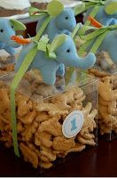 Party Frosting: Pastel Safari - Baby Shower Theme - would do these with pink elephants and the frosted animal crackers