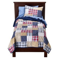 "Circo plaid quilt set. This would kind of be a splurge for me at $90, but I think it would be perfect for Carter's ""firetruck"" bed in his brown and blue room"